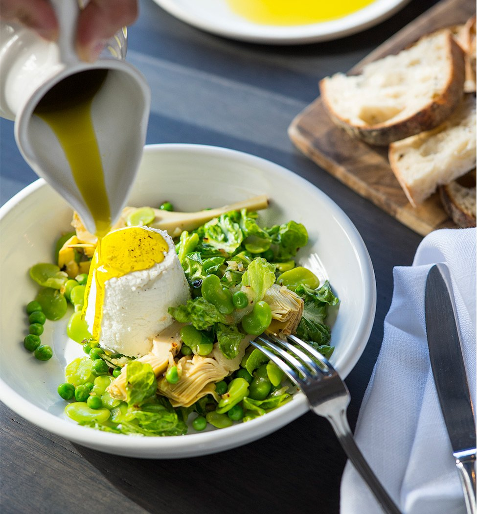 Ricotta with oil poured on broad beans